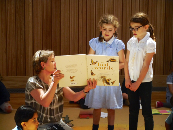 Children looking at the Lost Words book