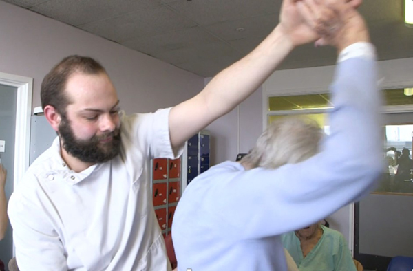 Darren, Healthcare Assistant dancing with a patient